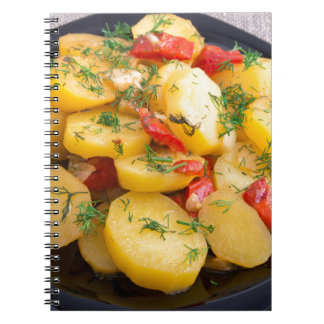 Stew of potatoes with onion, bell pepper and dill notebooks