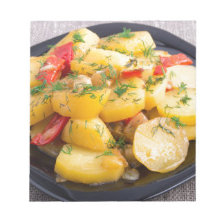 Stew of potatoes with onion, bell pepper and dill notepad