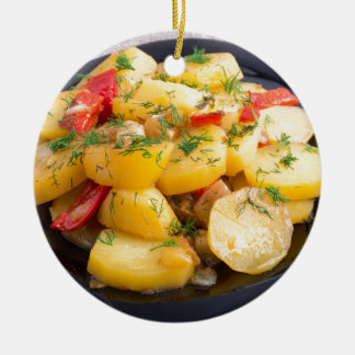 Stew of potatoes with onion, bell pepper and dill round ceramic ornament