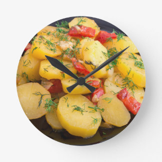 Stew of potatoes with onion, bell pepper and dill round clock