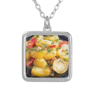 Stew of potatoes with onion, bell pepper and dill silver plated necklace