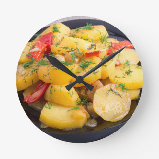 Stew of potatoes with onion, bell pepper and dill wallclock