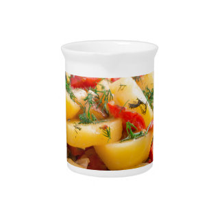 Stew of potatoes with onion, bell pepper, fennel beverage pitcher