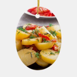 Stew of potatoes with onion, bell pepper, fennel ceramic oval ornament