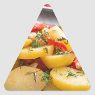 Stew of potatoes with onion, bell pepper, fennel triangle sticker