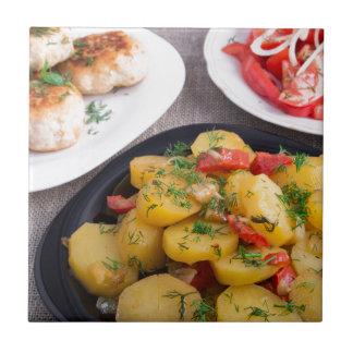 Stewed potatoes, meatballs minced chicken tiles