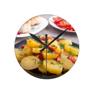 Stewed potatoes with bell pepper closeup clocks