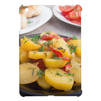 Stewed potatoes with bell pepper closeup iPad mini case