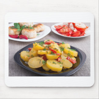 Stewed potatoes with bell pepper closeup mouse pad