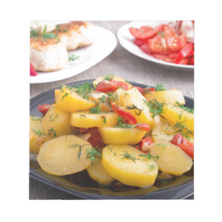 Stewed potatoes with bell pepper closeup notepad