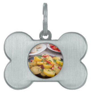 Stewed potatoes with bell pepper closeup pet name tag