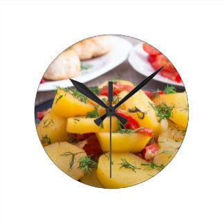 Stewed potatoes with bell pepper closeup wallclocks