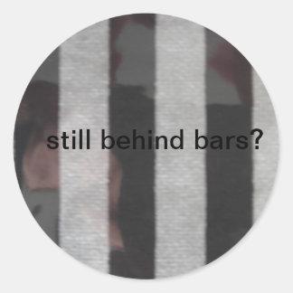 Still behind bars? round sticker