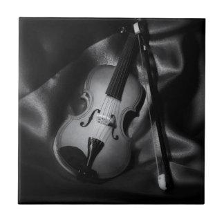 Still-life b&W image of a violin Tile