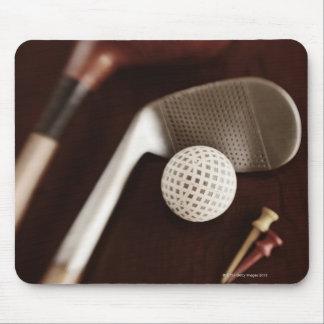 Still life if vintage golf clubs, tees and ball. mouse pad