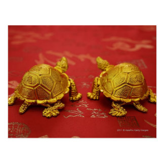Still life of a pair of gold tortoise figurines postcard