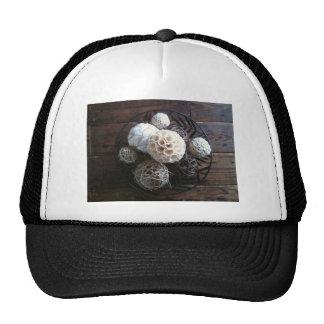still life of round centerpiece mesh hat