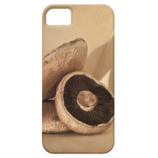 Still life with flat mushrooms and dramatic case for the iPhone 5
