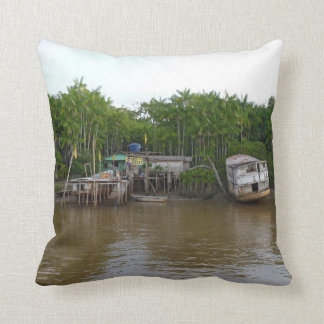 Stilt houses on Amazon river Throw Pillow