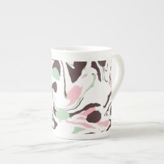 Stirred colors on white tea cup