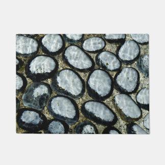 Stones under Water Doormat