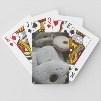Stones with holes seaside playing cards