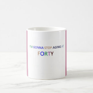 Stop aging at forty white,pink 11oz coffee mug