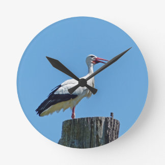 Stork with blue sky (Storch) Round Clock