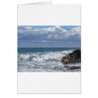 Stormy sea and sailboat along Tuscany coastline Card