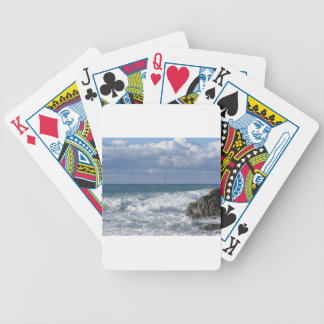 Stormy sea and sailboat along Tuscany coastline Poker Deck