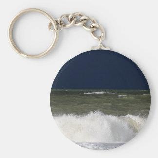Stormy sea with waves und a dark blue sky. basic round button keychain