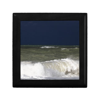 Stormy sea with waves und a dark blue sky. gift boxes