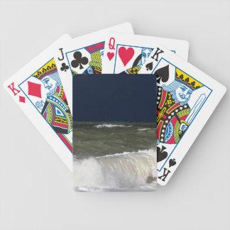 Stormy sea with waves und a dark blue sky. poker deck
