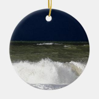 Stormy sea with waves und a dark blue sky. round ceramic ornament