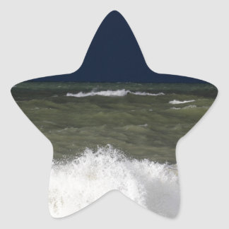 Stormy sea with waves und a dark blue sky. star sticker