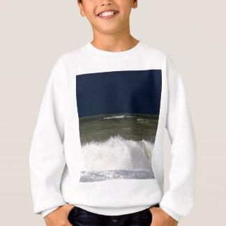 Stormy sea with waves und a dark blue sky. sweatshirt