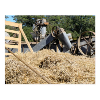 Straw Piled Up In Front Of Old Machinery Postcard