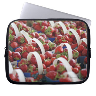 Strawberries at a market stall laptop sleeve