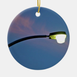 Street light against a sunset cloud ceramic ornament