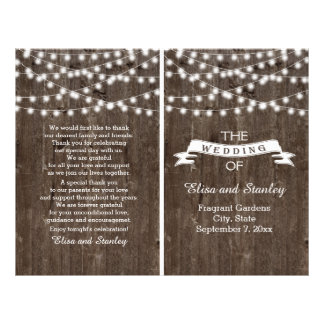 String lights on old wood folded wedding program