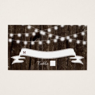 String of lights  on old wood wedding place card