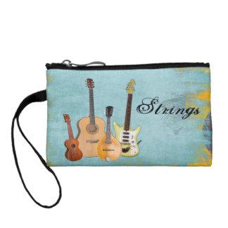 Strings-Four Instruments Change Purses