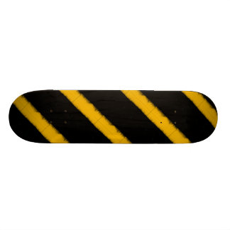 Striped yellow and black skateboards