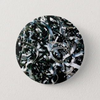 strips of garbage metal 2 inch round button