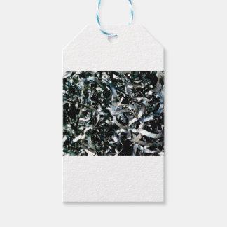 strips of garbage metal gift tags