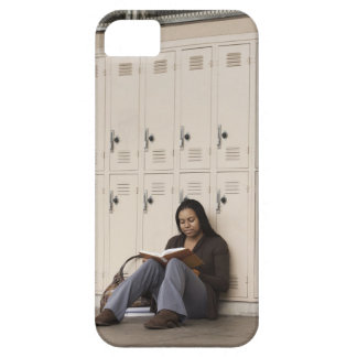Student leaning on school lockers studying iPhone 5 covers