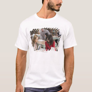 Student talking to librarian in school library T-Shirt