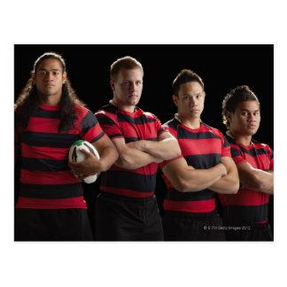 Studio portrait of male rugby team postcard