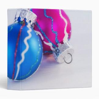 Studio shot of christmas baubles vinyl binders