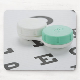 Studio shot of contact lens case on eye chart mouse pad